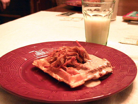 Savory waffle with onions, carrots, and mustard sauce