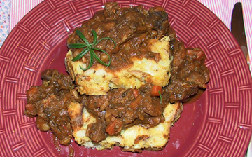 savory bread pudding with pork stew